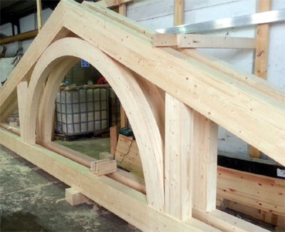Glulam roof rame with integral arch