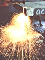 Welding sparks being deflected by Weld Stop Fabric